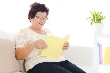 Asian senior woman reading