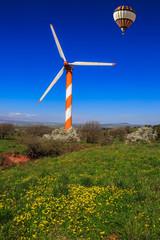 Over  huge windmill flying balloon