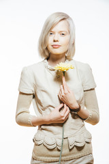 strange slim blonde girl with a yellow flower