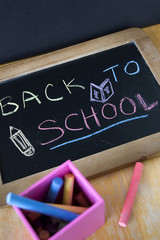 back to school concept on chalkboard