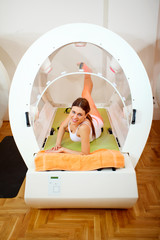 woman on the Thermoslim therapy exercise in capsule