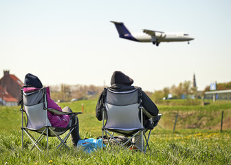Couple watching airplanes