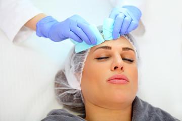 beauty treatment, squeezing pimples