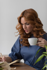 Woman coffee while working at home or office