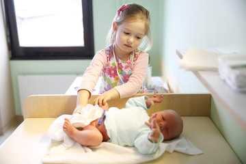 Sister with her newborn brother