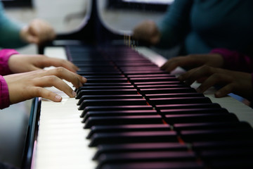 Teenager performing on a piano