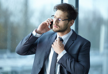 businessman talking by phone in the office