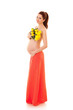 Beautiful pregnant woman with yellow flowers on the white