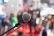 Microphone in focus against blurred audience - 81821967