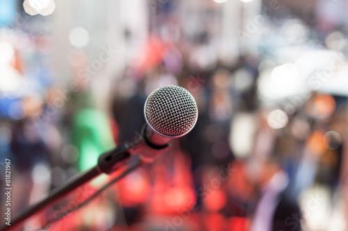 Leinwanddruck Bild Microphone in focus against blurred audience