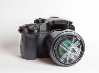 Digital reflex camera with the front lens broken.