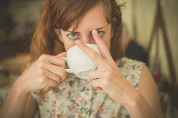 Woman drinking coffee and swearing