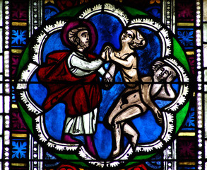 Creation of Eve in stained glass