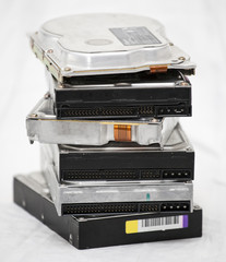Old hard disk drives in a pile