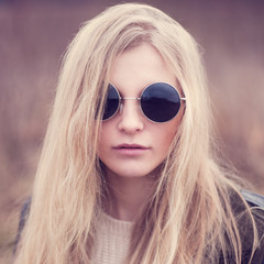 portrait of a beautiful girl in glasses hipster