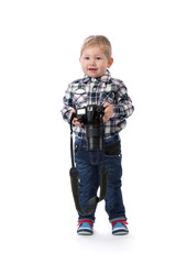 three-year boy with a camera in hand in the studio.