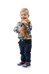 three year old boy with a toy bear on white background