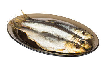 Smoked herring in black transparent glass dish