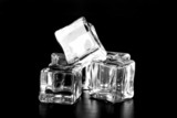 Ice cubes on black table. Selective focus