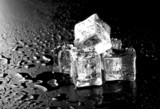 Ice cubes on black wet table. Selective focus