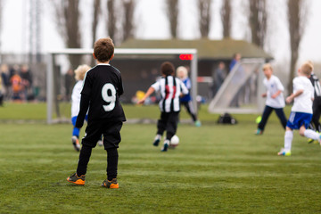 Young soccer players during boys soccer game