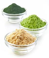 three bowls of various superfood powders
