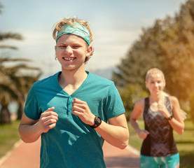 Young couple run together in summer day