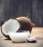 Fototapety Coconuts and organic coconut oil in a glass jar