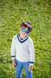 Cheerful little boy having relax outdoors