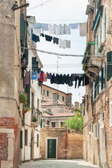 Scenery of hanging clothes in Venice, Italy.