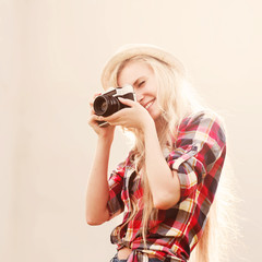 beautiful laughing girl with hipster vintage camera