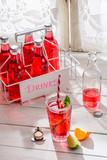 Fotoroleta Tasty red summer drink in bottle with mint leaf