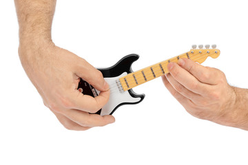 Hands and toy electric guitar