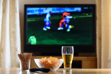 television, TV watching (football, soccer match) with snacks