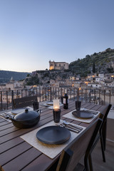 Italy, Sicily, Scicli, view of the town at sunset from a terrace