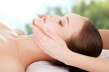 Woman recieving face massage.