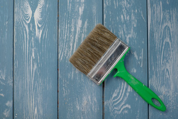 Paint brush on a blue wooden table.