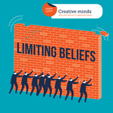 Businessmen knocking down a wall with limiting beliefs