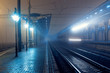 Leinwandbild Motiv High speed passenger train on tracks with motion blur effect