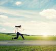 woman in formal wear running fast