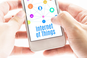 Close up Two hand holding smartphone with Internet of things wor