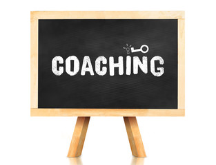 coaching word and key icon on blackboard with easel and reflecti