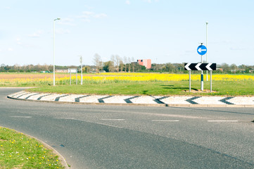 Modern road and roundabout in rural England