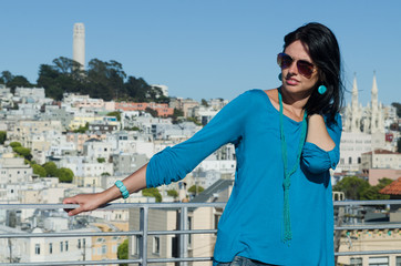 Young woman with San Francisco on the background