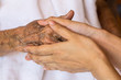 Hand of woman touching senior woman in clinic. - 81843339
