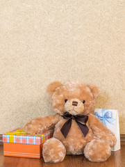 Soft toy and gift boxes on the wooden floor