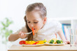 child eating healthy food at home