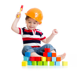 smiling child with hard hat and toy hammer