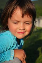 the child blinks in the sun