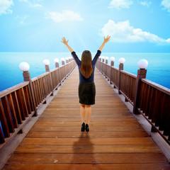 Woman Raise Hand On The Pier